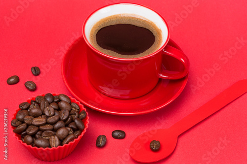 Spoed Foto op Canvas Cafe red cup with a drink of coffee with foam on a red background