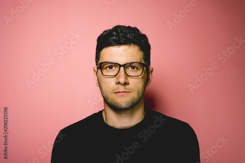 Fototapety, obrazy: Young man with eyeglasses on pink background