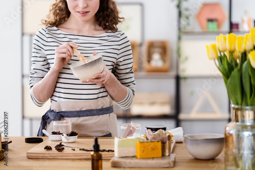 Fotografie, Obraz  Woman making organic face cream