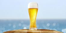 Summer Beer On Desk And Blurred Sea Landscape