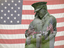 Double Of Exposure Of Veteran Statue And American Flags In Cemetery
