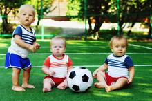 Three Little Kids In A Sports ...