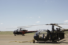 Alouette III Passing A Stationary Alouette II On Runway