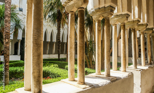 """Paradise Yard"" is patio with gallery with pointed carved arches, adjacent to Cathedral of St Canvas Print"