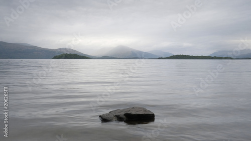 Canvas Prints Mountains Moody loch lake atmospheric grey clouds dark water Lomond Scotland highlands landscape scene outdoors