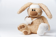 Cute Sick Bandaged Hare On A White Background.