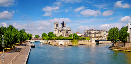 Fotografia  Paris, river Seine with Notre-Dame cathedral from the back on a bright day in Sp