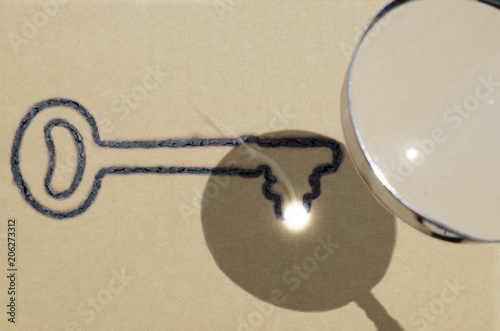 Fotografie, Obraz  Focus is key (one key version), illustrated by using magnifying glass to focus s