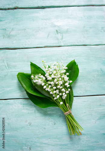 Staande foto Lelietje van dalen lilly of the valley flowers on wooden surface