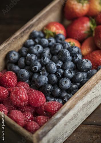 Fotobehang Wintersporten Closeup of fresh bluberries and raspberries