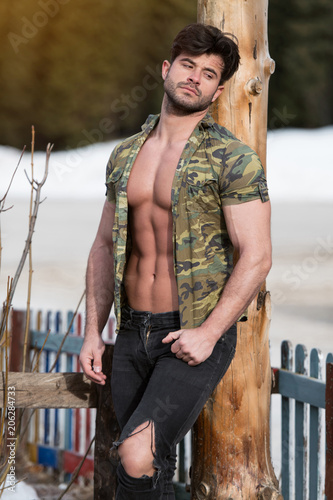 Fototapety, obrazy: Model Flexing Muscles Outdoors in Nature