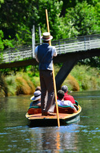 Unrecognizable People Punting On The Avon River Christchurch - New Zealand
