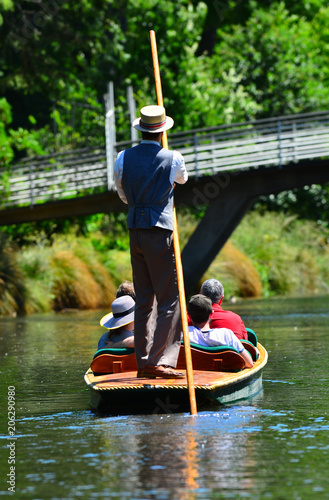 Staande foto Oceanië Unrecognizable people punting on the Avon river Christchurch - New Zealand