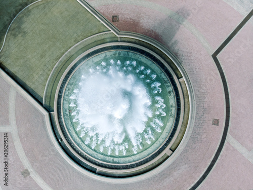 Poster de jardin Fontaine aerial view of large round fountain in city square. drone photography