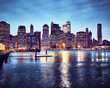 Manhattan skyline reflected in East River at dusk, color toned picture, New York City, USA.