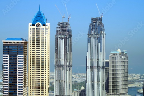 Photo Stands Kuala Lumpur Tall skyscrapers with beautiful blue sky in background.