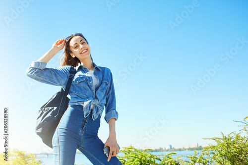 portrait of a young smiling attractive woman in jeans