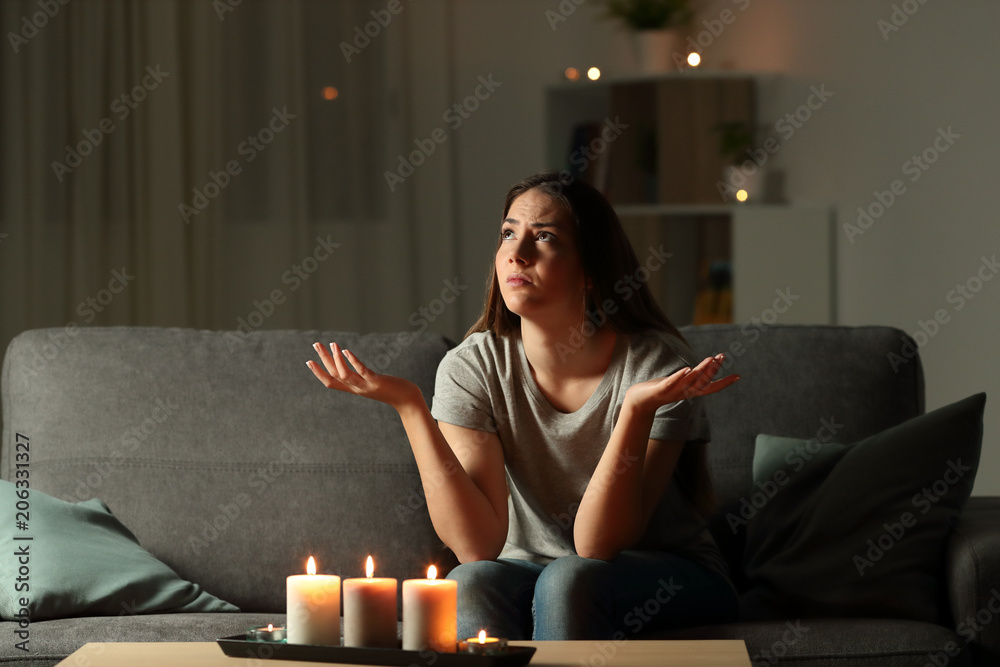 Fototapeta Woman complaining during a blackout at home