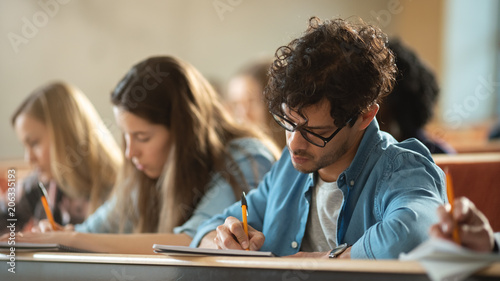 Fotografía  Shot of a Row of Multi Ethnic Students in the Classroom Taking Exam/ Test