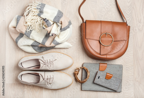 women's flat lay clothes shoes, scarf, bracelet, bag, tablet, smartlphone. Fashion blog, clothing, shopping