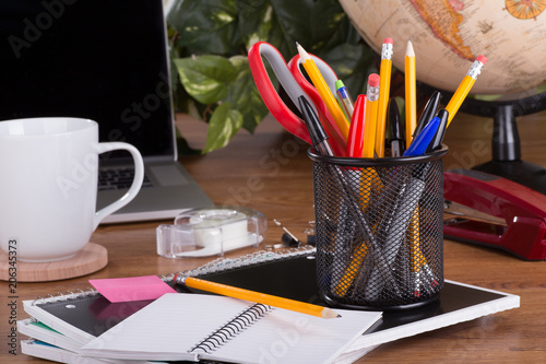 Fotografie, Obraz  Assortment of Office Supplies on a Desktop
