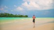 man runs along tropical beach