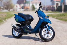 Blue Modern Scooter On The Gra...