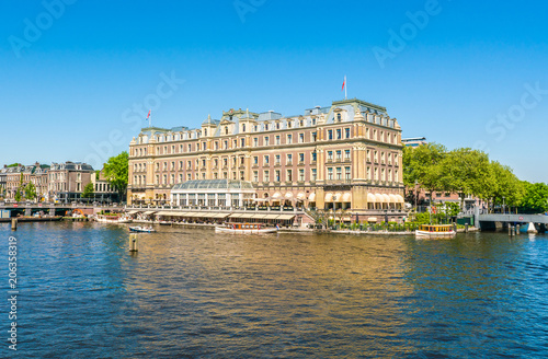 Obraz Amsterdam, May 7 2018 - the famous five star Amstelhotel at the river Amstel in summertime - fototapety do salonu