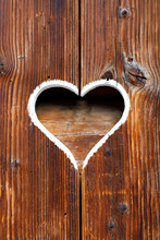 Wooden Fence With Heart. Part Of A Window In Tirol, Austria