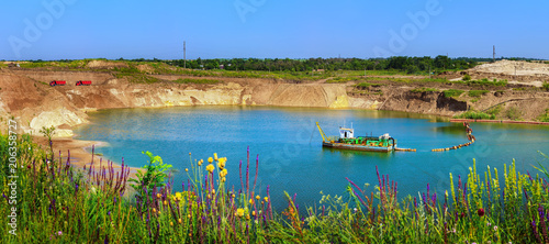 Lake in the sand quarry with the dredge Canvas Print