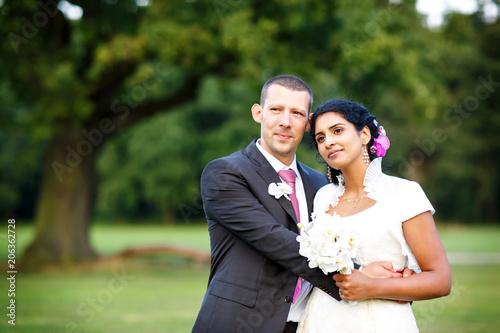 Beautiful Indian Bride And Caucasian Groom In Summer Park Happy