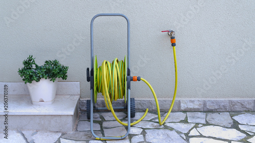 garden hose for irrigation near the house wall Canvas-taulu