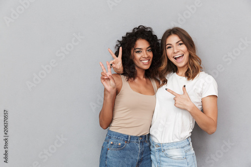 Portrait of two cheerful young women standing together