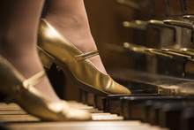 An Organist With Golden Shoes Playing The Organ