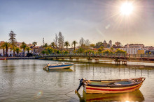 The Sun Shines Over The Portuguese Village Of Tavira On The Banks Of River Gilao.