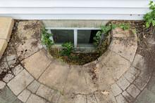 Abandoned Egress Window In A House Basement