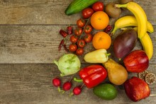 Different Types Of Vegetables And Fruits On A Wooden Table. Concept Of Healthy Food. Dietary Foods.