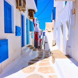 Fototapeta Fototapeta uliczki - Old street with white houses in Mykonos