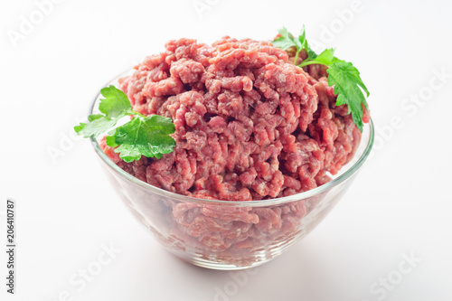 Staande foto Vlees Raw minced meat in a plate on white background