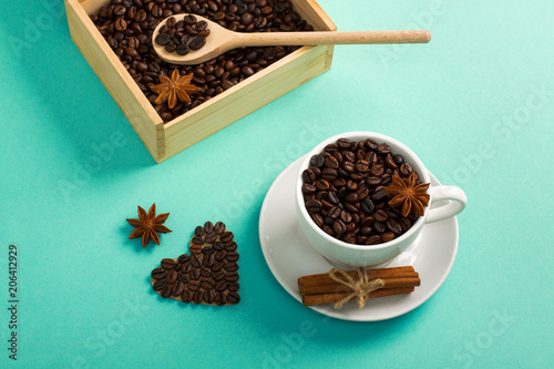 Fotografie, Tablou  Wooden box spoon with coffee seeds cup of coffee hearts