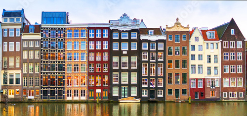 Foto op Plexiglas Amsterdam Amsterdam, The Netherlands, May 4th 2017: Row of authentic canal houses on the Rokin in Amsterdam