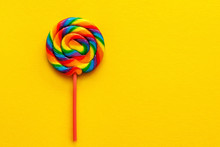 Multicolored Lollipop On Yellow Background, Top View. Flat Lay, Copy Space
