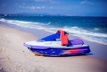 Hidrocycle Jet-ski On Beach Of The Sea Against The Blue Sky