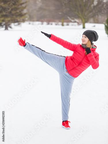 Foto op Plexiglas Vechtsport Woman wearing sportswear training boxing outside