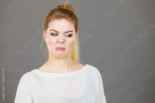 Fotografie, Tablou  Woman having disgusted face expression