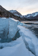 Giant Chunks Of Ice Cover The Side Of Lundy Lake In Mono County California