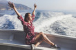 Happy young amazing woman wearing relaxing on the yacht in Cinque Terre, Italy, Ligurian Sea
