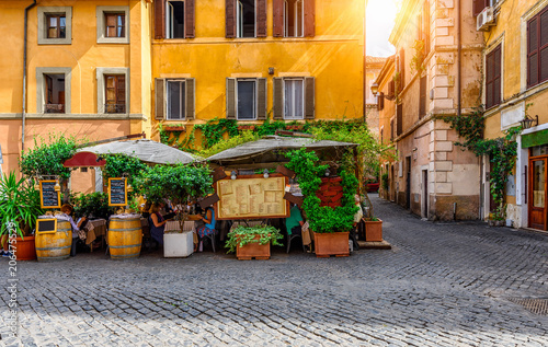 View of old cozy street in Trastevere in Rome, Italy.  Trastevere is rione of Rome, on the west bank of the Tiber in Rome, Lazio, Italy.  Architecture and landmark of Rome