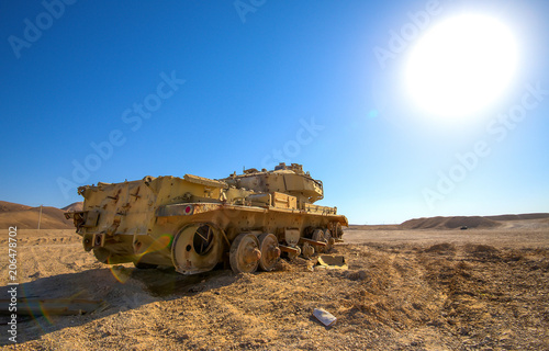 destroyed tank under desert sun landscape buy this stock photo and