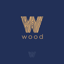 W Flat Logo. W Wood Emblem. Letter W With A Wooden Texture On A Dark Background. Monochrome Contour Option.